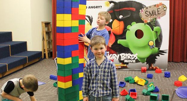 Photo of child with the giant lego