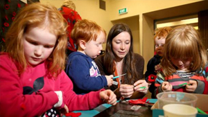 Sunny McIntyre, 6, Dale McIntyre, 2, Invercargill Public Library customer experience assistant Grace Roscoe,