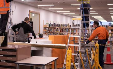 Workmen in the Library